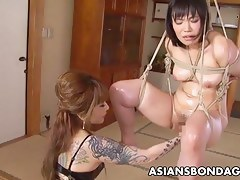 Asian bondage infant is fisted