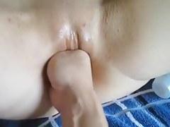 Fisting her bald snatch deep
