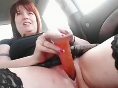 Honcho redhead masturbates in the car