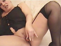 Experienced big beautiful doll stuffing her twat