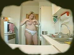 large nice-looking woman Wife masturbates in kitchen (Hidden Webcam)