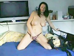 lickerish milf stips and rubs her cunt