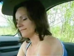 Brunette chick gives a blowjob in the car