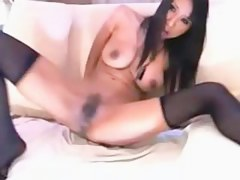 Brunette masturbates with sexual congress toy