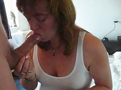 Aged wife swallows his large load down her outlook hole
