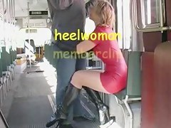 Crestfallen Wife in Latex and High Heels Chatelaine Sucks Strapon in Tram