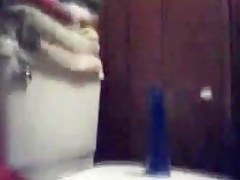 Riding blue dildo fro a bathroom