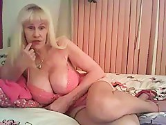 Webcam granny showing her large hooters