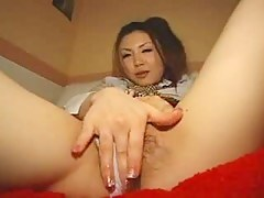 Japanese girl rubs the brush cunt thru the brush panties