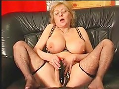 Horny mature slut fucks a big sex toy