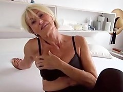 Beautiful granny strips off her raiment