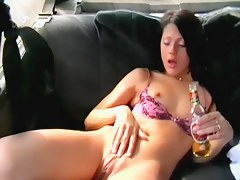 Lewd spycam girl drinks beer and rubs cunt in taxi