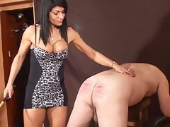 Busty dominatrix up hot caning action
