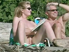 Mature pussy wide open on the shore captured on spy cam