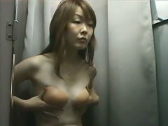 Small breasted Asian cutie on a changing room spy cam