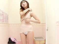 Japanese girl is trying on unmentionables in the unmentionables shop dressing room