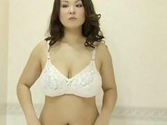 Fem with big tits tries to choose rub-down the lingerie on voyeur cam