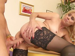 Blonde MILF in stockings sucks and fucks