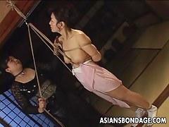 Asian cosset in all directions rope bondage scene