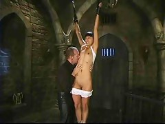 Dana Vespoli hung by wrists, whipped
