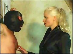 Bad blonde dominatrix nearby spanking action with her serf