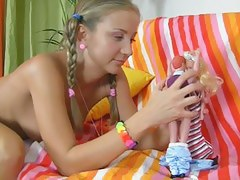 blond with pigtails began to play with a pink marital-device