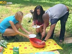 Men together with women have sexual fun on a picnic